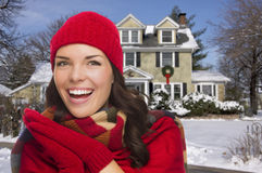 Smiling Mixed Race Woman in Winter Clothing Outside in Snow Stock Photos