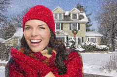 Smiling Mixed Race Woman in Winter Clothing Outside in Snow Stock Photo