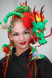 Smiling model with fanciful braiding hairdo Stock Photo