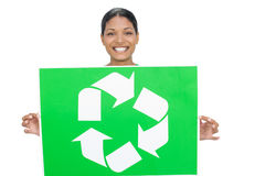 Smiling model holding recycling sign Royalty Free Stock Photo