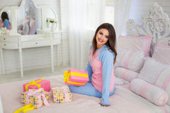 Smiling model near dressing table royalty free stock photography