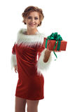 Smiling model posing in studio with gifts. Beautiful Santa Girl. Isolated white background Royalty Free Stock Photo