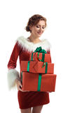 Smiling model posing in studio with gifts. Beautiful Santa Girl. Isolated white background Stock Photography