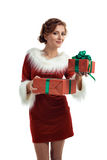Smiling model posing in studio with gifts. Beautiful Santa Girl. Isolated white background Stock Photo