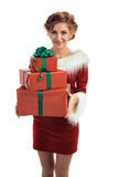 Smiling model posing in studio with gifts. Beautiful Santa Girl. Isolated white background Royalty Free Stock Photos