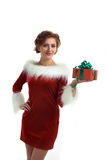 Smiling model posing in studio with gifts. Beautiful Santa Girl. Isolated white background Stock Images