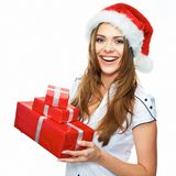 Smiling model posing in studio with gifts. Beautiful Santa Girl. Isolated white background Stock Image