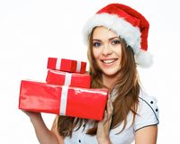 Smiling model posing in studio with gifts. Beautiful Santa Girl. Isolated white background Royalty Free Stock Image