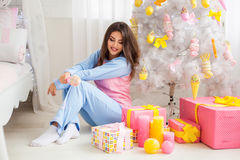 Smiling model in pyjamas Royalty Free Stock Images
