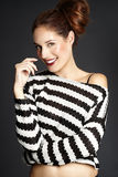 Smiling Model. Smiling red-haired girl in striped jumper Royalty Free Stock Photos