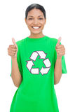 Smiling model wearing recycling tshirt giving thumbs up Stock Photo