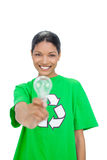 Smiling model wearing recycling tshirt holding light bulb Stock Images