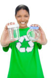 Smiling model wearing recycling tshirt holding pots Stock Photos