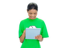 Smiling model wearing recycling tshirt holding tablet Stock Photos