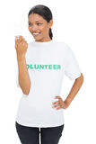 Smiling model wearing volunteer tshirt holding light bulb Stock Photography