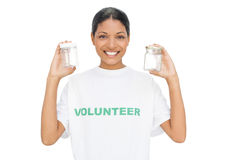 Smiling model wearing volunteer tshirt holding pots Royalty Free Stock Photography