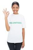 Smiling model wearing volunteer tshirt making okay gesture Stock Image
