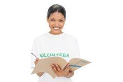 Smiling model wearing volunteer tshirt writing Stock Photos