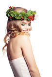 Smiling Model Woman with Blonde Hair and Makeup. Laughing. Permed Hairstyle and Christmas or New Year Wreath Isolated Royalty Free Stock Photo