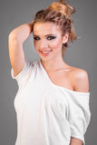 Smiling model woman in white t-shirt Stock Photography