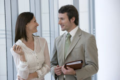 Smiling modern business couple Royalty Free Stock Image