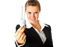 Smiling modern business woman holding lamp in hand Stock Photos