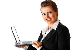 Smiling modern business woman holding laptop. In hand isolated on white stock photos