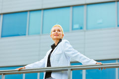Smiling modern business woman looking at copyspace Stock Images
