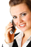 Smiling modern business woman  with mobile phone. Isolated on white Stock Photography