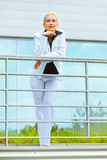 Smiling modern business woman at office building Stock Photography