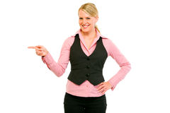 Smiling modern business woman pointing corner Stock Photos