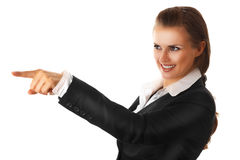Smiling modern business woman pointing finger Royalty Free Stock Photography