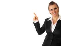 Smiling modern business woman pointing finger. On isolated on white stock photography