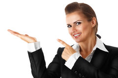 Smiling modern business woman pointing finger on e. Mpty hand isolated on white royalty free stock photography