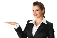 Smiling modern business woman presenting something. On empty hand isolated on white royalty free stock image