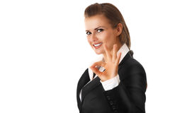 Smiling modern business woman showing ok gesture. Isolated on white stock photo