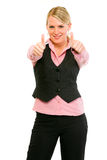 Smiling modern business woman showing thumbs up Royalty Free Stock Image