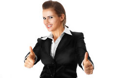 Smiling modern business woman showing thumbs up ge. Sture isolated on white stock images