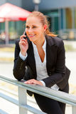 Smiling modern business woman  talking on mobile Stock Image