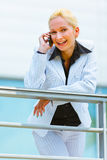 Smiling modern business woman  talking on mobile Royalty Free Stock Images