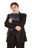 Smiling  modern businessman hugging  laptop Royalty Free Stock Photo