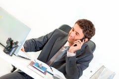 Smiling modern businessman talking on mobile Royalty Free Stock Images