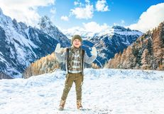 Smiling modern girl in South Tyrol, Italy showing mittens Royalty Free Stock Photos