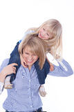 Smiling mom with child play on shoulders Stock Images