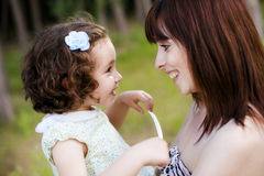 Smiling mom and daughter Royalty Free Stock Photo