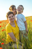 Smiling mom and her children Stock Photography