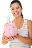 Smiling Mom Holding Piggy Bank Stock Image