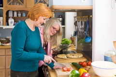 Smiling Mom Showing her Recipe to her Friends Royalty Free Stock Photo