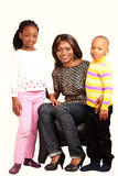 Smiling mommy with children. In happy family portrait royalty free stock photography