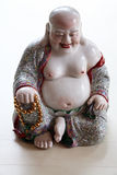 Smiling monk statue Royalty Free Stock Images